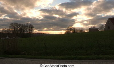 Sunset in the Belgian countryside - Sunset with clouds in...