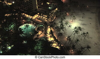 Waikiki at night - Honolulu skyline from above, Hawaii, tilt