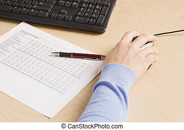 balance sheet blues - woman\'s hand on mouse at workstation...