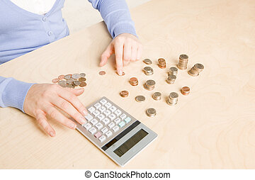 counting coins - woman stacking and organizing change