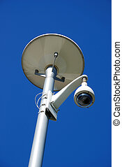 security camera under streetlight over the blue sky...
