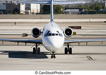 Commercial Jet on Airport Tarmac - Head on view of...