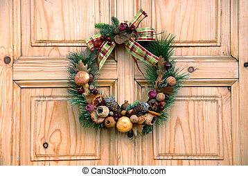 Christmas door decoration - Christmas wreath on wooden door...