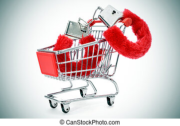 sexy fluffy handcuffs in a shopping kart - a pair of red...