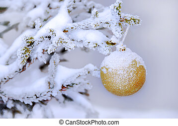 Christmas ball - christmas golden ball on snowy new year...