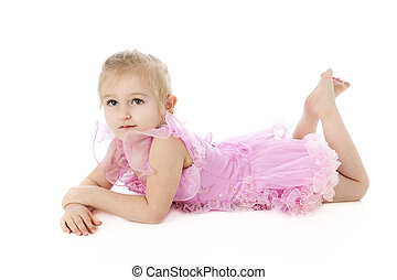 Relaxed Little Dancer - An adorable preschool dancer resting...