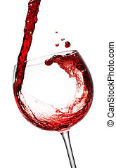 Red Wine being poured in a wine glass; isolated on a white...