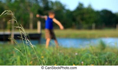 boy skipping stones