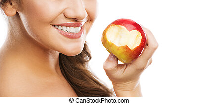 Woman with apple - Smiling beautiful woman holding red apple...
