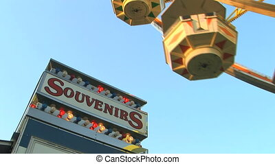 Souvenir Stand - Souvenir stand and ferris wheel at the...