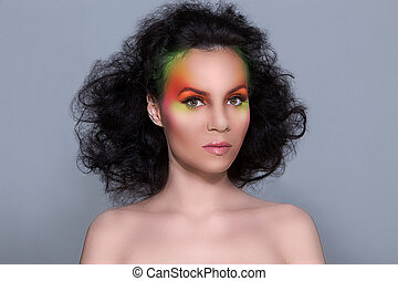 Attractive woman with colored make-up - Beautiful girl with...