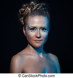 Attractive woman with artistic make-up - Beautiful girl with...