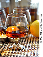 Brandy and lemon - a glass of brandy, lemon and candles