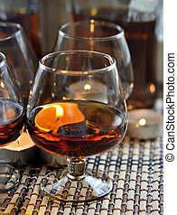 Brandy - a glass of brandy and the candles