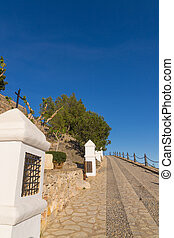 Via crucis - Steep street following a via crucis uphill