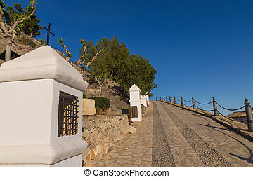 Uphill via crucis - Uphill street with several via crucis...