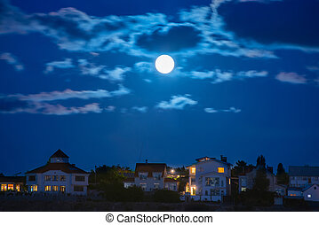Moon over the town - Moon over the river by the town with...