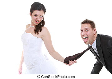 Emancipation idea. Woman pulling on mans tie, funny couple -...
