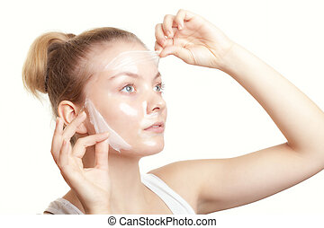 Girl woman in facial peel off mask. Skin care. - Portrait of...