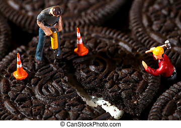 Construction Workers in Conceptual Imagery With Cookies -...