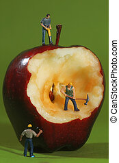 Construction Workers in Conceptual Imagery With an Apple -...