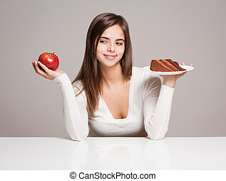 Food and health. - Portrait of a gorgeous young brunette...