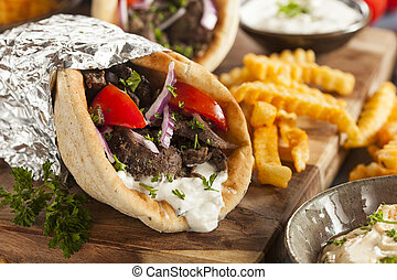 Homemade Meat Gyro with French Fries - Homemade Meat Gyro...