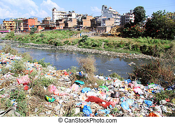 Garbage and river - Garbage on the river bank in Khatmandu,...