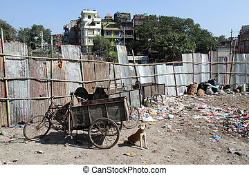 Garbage - Three-wheeled bicycle and garbage in Khatmandu,...