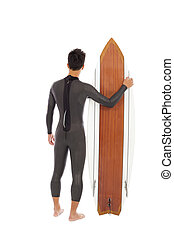surfing man wore wet suit and holding surfing board