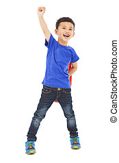 confident Superhero kid make a flying pose