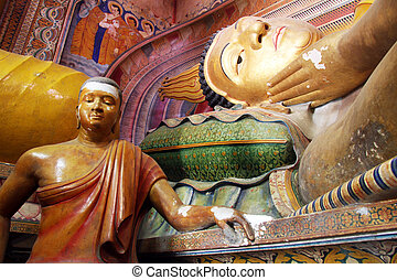 Sleeping Buddha and statues in Wewurukannala Vihara near...