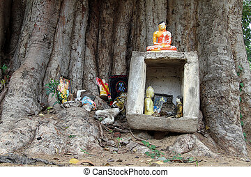 Buddhist shrine - Small buddhist shrine with Buddhas under...
