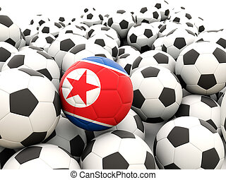 Football with flag of north korea in front of regular balls