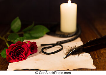 love and sweet pain - letter, whip, candle and rose