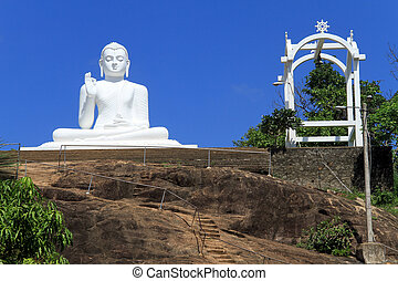 White Buddha - Big white statue of Buddha on the rock in...