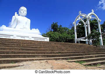 Staircase and Buddha - Wide staircase and big Buddha in...