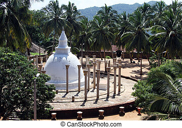 Ambasthala stupa with columns and palm trees in Mihintale,...