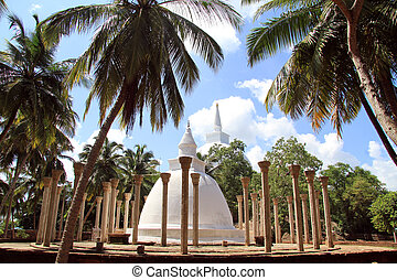Ambasthala stupa and palm trees in Mihintale, Sri Lanka