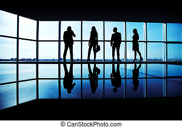 Business team - Silhouettes of several office workers...