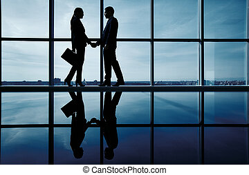Business deal - Outlines of two business partners...