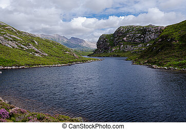 scottish lake (loch) in mountain scenery - stock photo