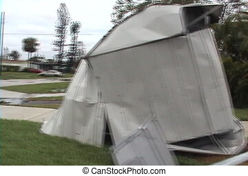 Hurricane Storm Damage - A shed wrapped around a tree.
