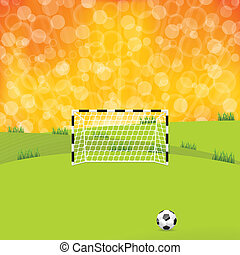 Soccer ball and gate with sunset background