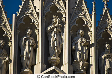 Saints - statues of Mary and the Apostel as church...