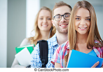 Smart students - Portrait of cute teenager looking at camera...