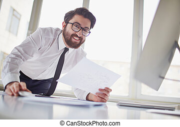 Satisfied businessman - Happy businessman with paper in hand...