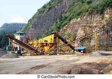 Gravel conveyor - Yellow gravel conveyor near high mount