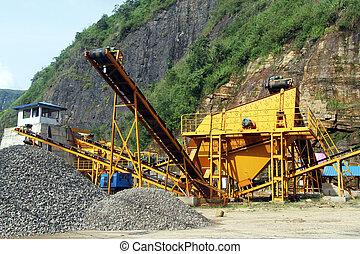 Gravel conveyor - Yellow big gravel conveyor near mount