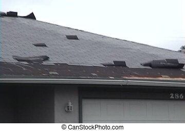 Hurricane Roof Damage - Hurricane winds create roof damage